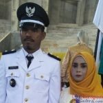 Kepala Desa Ranooha Raya, Marhalim bersama Istri